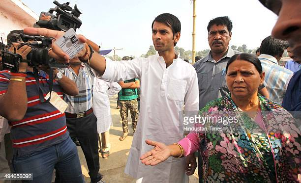 Rabri Devi former Chief Minister and wife of RJD Chief Lalu Yadav arrives with Tej Pratap for casting their vote at Veterinary College during the...