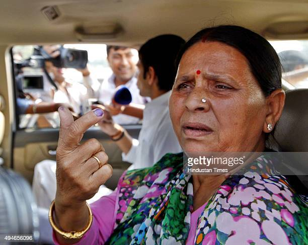 Rabri Devi former Chief Minister and wife of RJD Chief Lalu Yadav shows her ink stained finger after casting her vote at Veterinary College during...