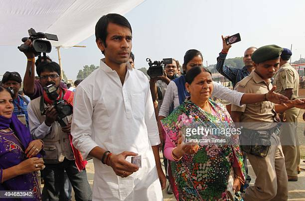 Rabri Devi former Chief Minister and wife of RJD Chief Lalu Yadav with her son Tej Pratap leaves after casting her vote at Veterinary College during...