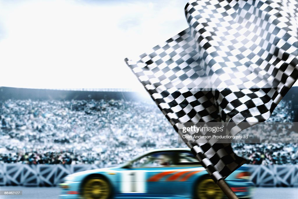 Race car crossing finish line : Stock Photo