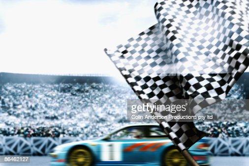 Race car crossing finish line : Stock Photo