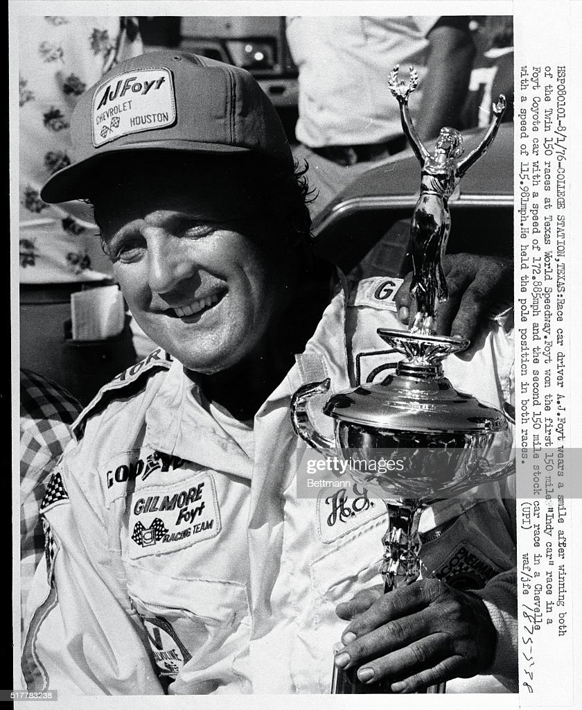 a j foyt holding racing trophy pictures getty images