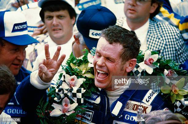 Race car driver Bobby Unser celebrates after winning the Indianapolis 500 He was later penalized one lap and stripped of the title