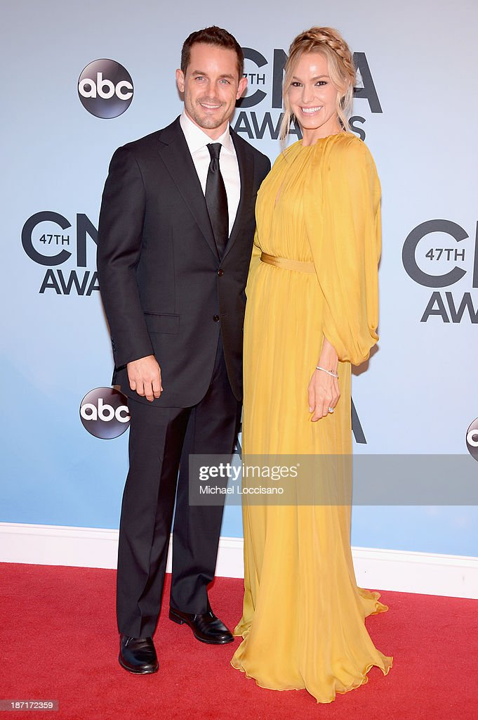 Race car driver Casey Mears (L) attends the 47th annual CMA Awards at the Bridgestone Arena on November 6, 2013 in Nashville, Tennessee.