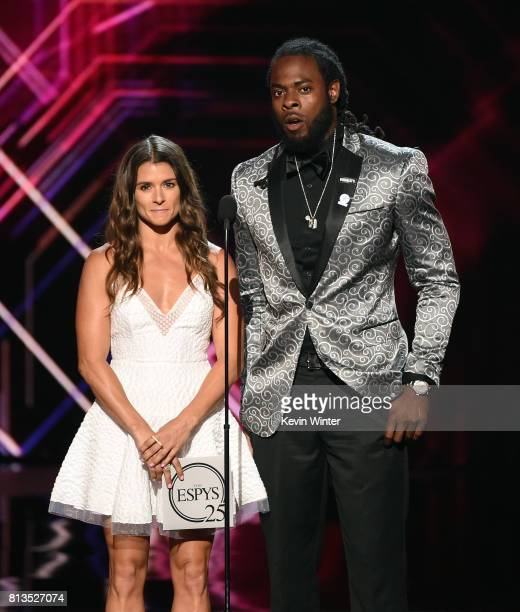 Race car driver Danica Patrick and Richard Sherman speak onstage at The 2017 ESPYS at Microsoft Theater on July 12 2017 in Los Angeles California