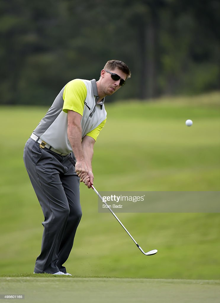 NASCAR race car driver <a gi-track='captionPersonalityLinkClicked' href=/galleries/search?phrase=Denny+Hamlin&family=editorial&specificpeople=504674 ng-click='$event.stopPropagation()'>Denny Hamlin</a> hits a chip shot on the second hole during the Pro-Am round of the FedEx St. Jude Classic at TPC Southwind on June 4, 2014 in Memphis, Tennessee.