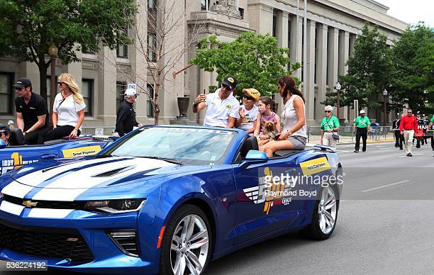Race car driver Helio Castroneves and his family makes their way South on Pennsylvania Street during the Indianapolis 500 Festival Parade in downtown...