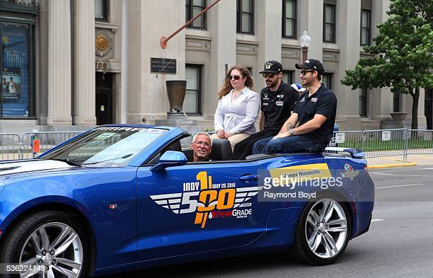 Race car driver James Hinchcliffe makes his way South on Pennsylvania Street during the Indianapolis 500 Festival Parade in downtown Indianapolis...