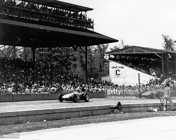 Race car driver Jim Rathman on the brick main stretch at the Indianapolis 500 race track Indianapolis Indiana May 1960