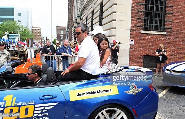 Race car driver Juan Pablo Montoya and his family makes their way South on Pennsylvania Street during the Indianapolis 500 Festival Parade in...