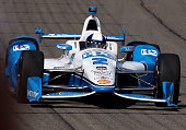 Race car driver Juan Pablo Montoya on the track during IndyCar series qualifying at the Auto Club Speedway on June 26 2015 in Fontana California