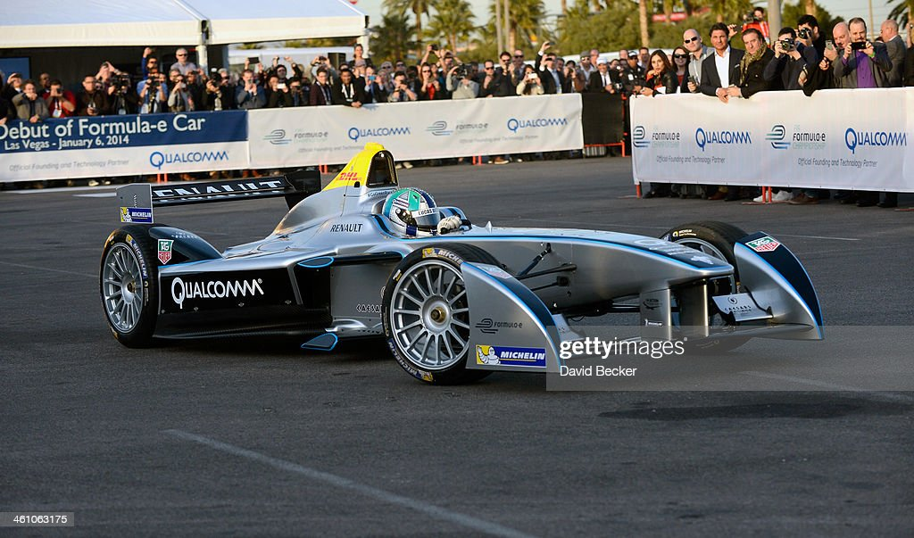 Race car driver <a gi-track='captionPersonalityLinkClicked' href=/galleries/search?phrase=Lucas+di+Grassi&family=editorial&specificpeople=4237493 ng-click='$event.stopPropagation()'>Lucas di Grassi</a> demonstrates Formula Es new fully-electric race car, the Spark-Renault SRT_01E during a press event at the Mandalay Bay Convention Center for the 2014 International CES on January 6, 2014 in Las Vegas, Nevada. CES, the world's largest annual consumer technology trade show, runs from January 7-10 and is expected to feature 3,200 exhibitors showing off their latest products and services to about 150,000 attendees.