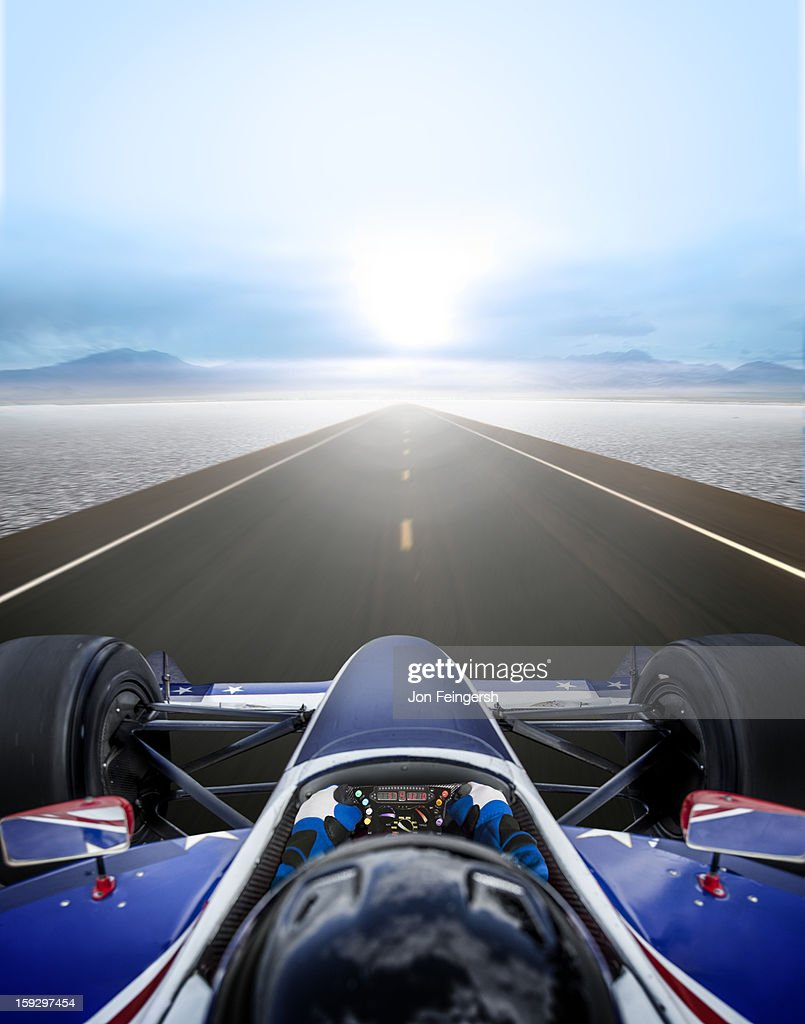 INDY race car driver on a straightaway in desert. : Stock Photo