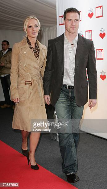 Race car driver Ralf Schumacher and his wife Cora Schumacher attend the Herz fuer Kinder charity gala at Axel Springer Haus December 16 2006 in...