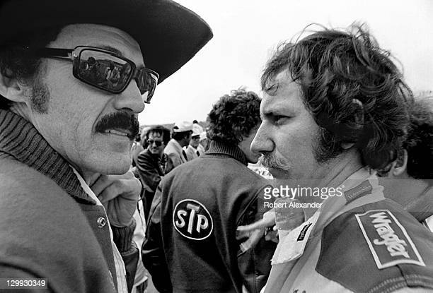 NASCAR race car driver Richard Petty left talks with fellow driver Dale Earnhardt Sr prior to drivers' introductions at the 1982 Daytona 500 on...