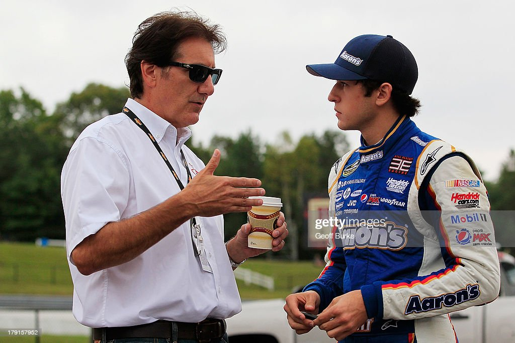 Race car driver Ron Fellows ( l ) talks to Chase Elliott, driver of the #94 Aaron's Dream Machine/Hendrickcars.com Chevrolet, during qualifying for the NASCAR Camping World Truck Series Chevrolet Silverado 250 at Canadian Tire Motorsport Park on August 31, 2013 in Bowmanville, Canada.