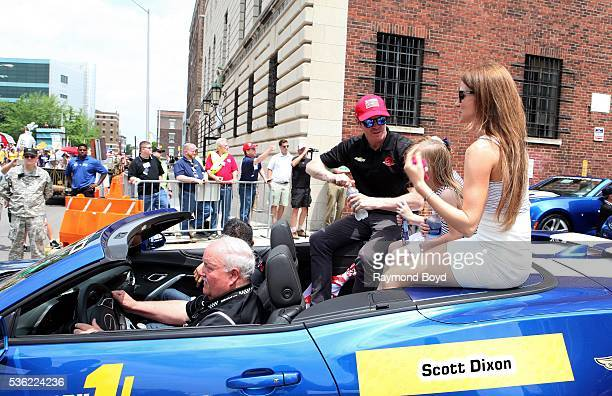 Race car driver Scott Dixon and his family makes their way South on Pennsylvania Street during the Indianapolis 500 Festival Parade in downtown...