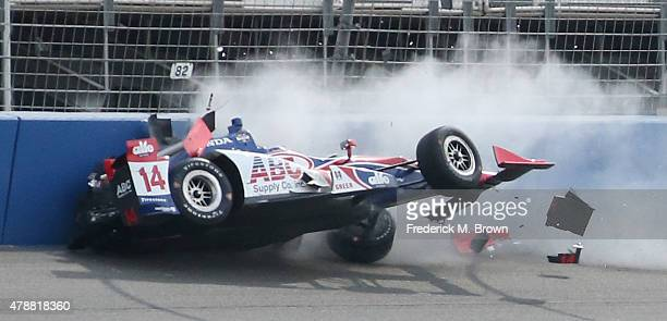 Race car driver Takuma Sato crashes during the Indy Car MAVTV 500 race at the Auto Club Speedway on June 27 2015 in Fontana California