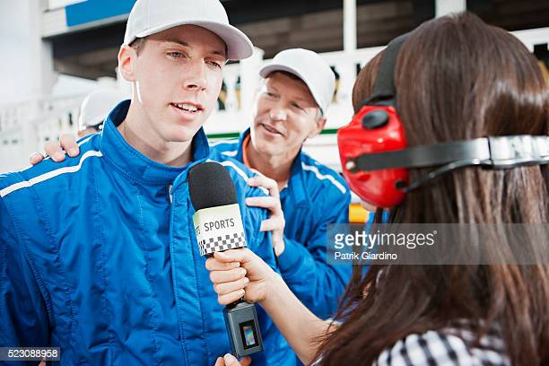 Race car driver talking to microphone