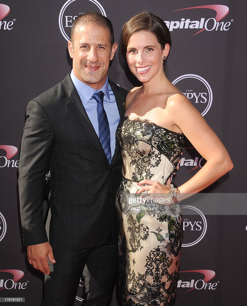 Race car driver Tony Kanaan and Lauren Bohlander Kanaan arrive at the 2013 ESPY Awards at Nokia Theatre L.A. Live on July 17, 2013 in Los Angeles, California.