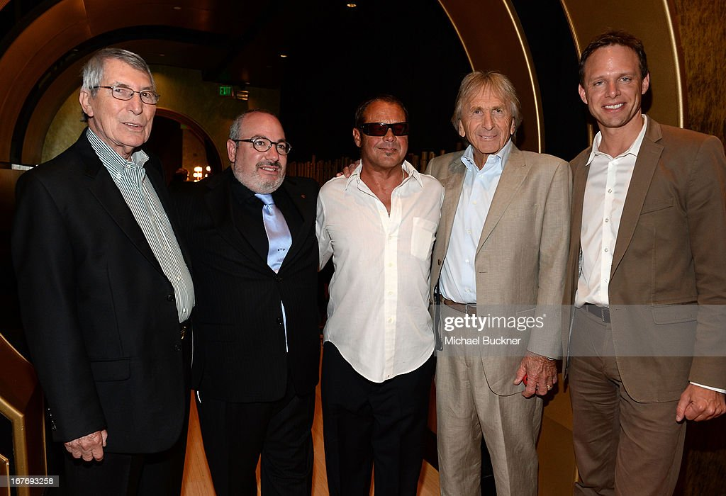 Race car driver Vic Elford guest Race car drivers Chad McQueen Derek Bell VP of Original Productions for TCM Tom Brown and guest attend 'Le Mans...
