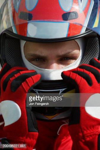 Race car driver wearing helmet, close-up, portrait : Stock Photo
