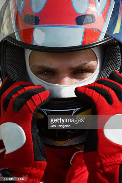 Race car driver wearing helmet, close-up, portrait