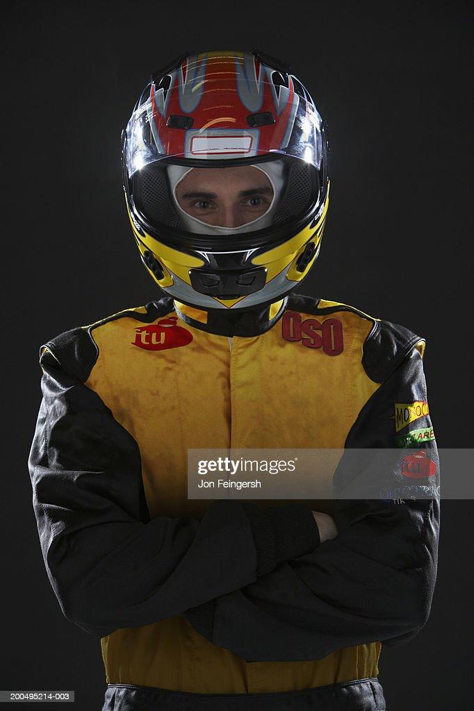 Race car driver wearing helmet, portrait