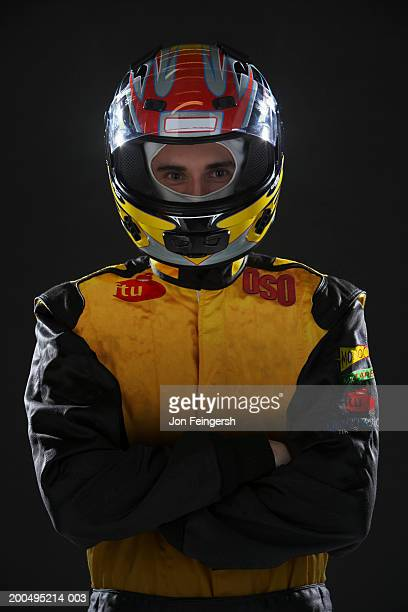 Race car driver wearing helmet, portrait