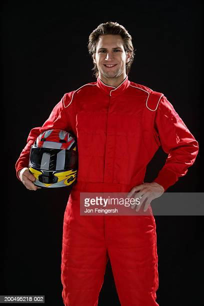 Race car driver with helmet, portrait