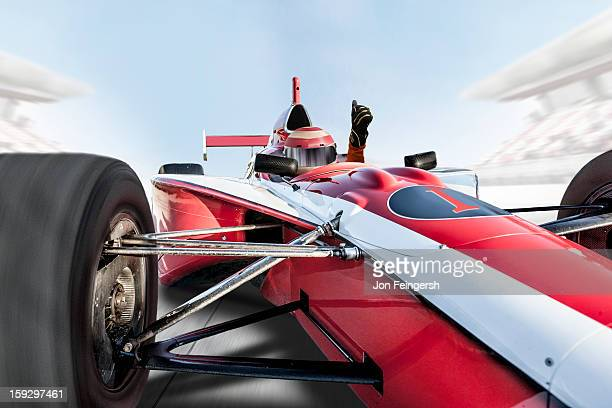 INDY race car driver with thumbs up.