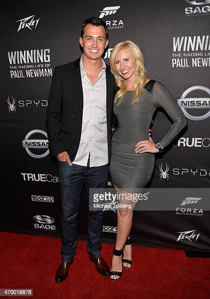 Race car drivers Graham Rahal and Courtney Force attend a charity screening of the film 'WINNING The Racing Life Of Paul Newman' at the El Capitan...