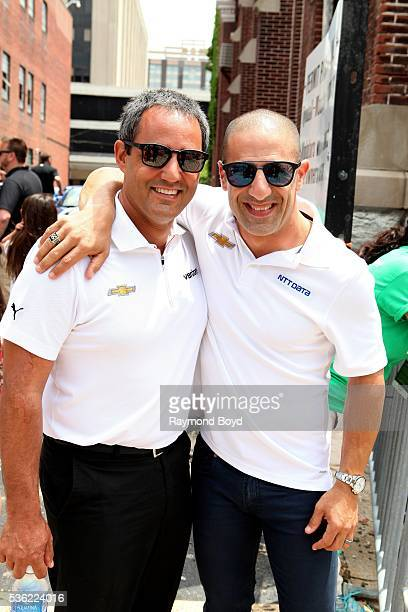 Race car drivers Juan Pablo Montoya and Tony Kanaan poses for photos during the Indianapolis 500 Festival Parade in downtown Indianapolis Indiana on...