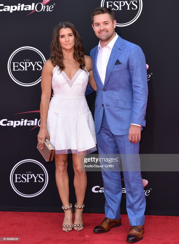 Race car drivers Ricky Stenhouse Jr. (L) and Danica Patrick arrive at the 2017 ESPYS at Microsoft Theater on July 12, 2017 in Los Angeles, California.