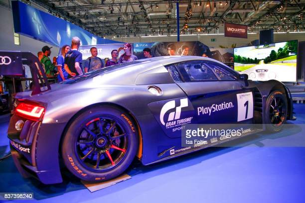 A race car is seen on display at the PlayStation stand at the Gamescom 2017 gaming trade fair on August 22 2017 in Cologne Germany Gamescom is the...