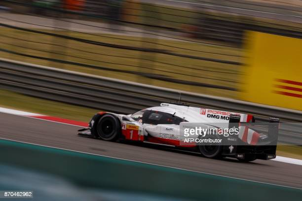 A race car of the Porsche LMP team Porsche 919 Hybrid Number 1 takes part in the FIA World Endurance Championship race in Shanghai on November 5 2017...