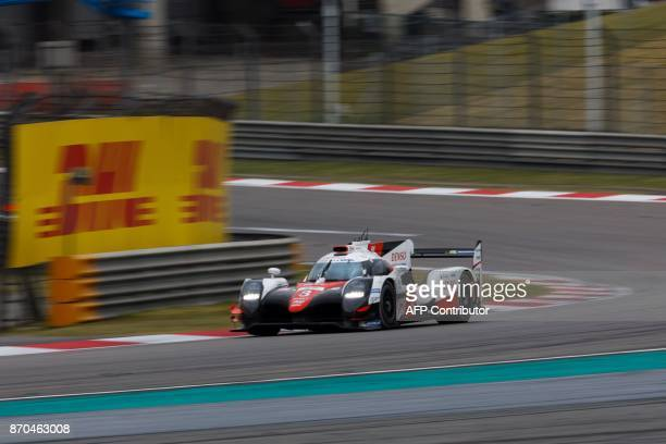 A race car of the Toyota Gazoo Racing team Tokyo TS050 Hybrid Number 8 takes part in the FIA World Endurance Championship race in Shanghai on...