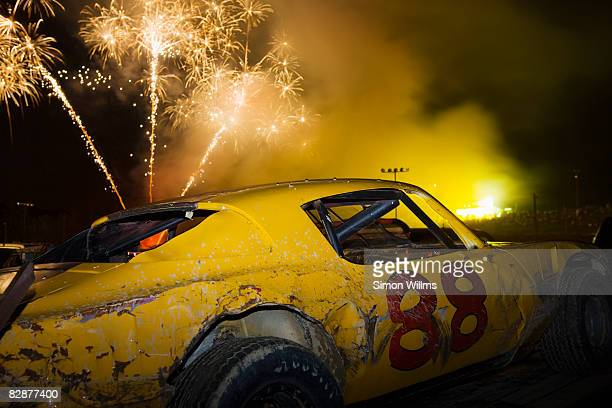 Race car with fireworks in background