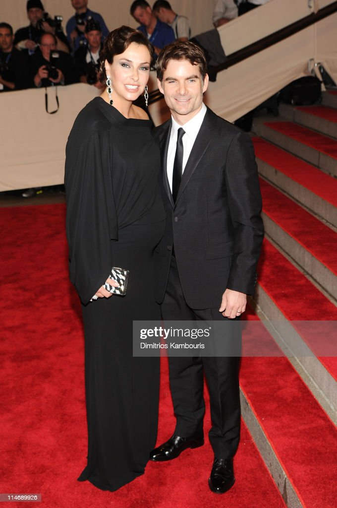 Race care driver Jeff Gordon (R) and Ingrid Vandebosch attend the Costume Institute Gala Benefit to celebrate the opening of the 'American Woman: Fashioning a National Identity' exhibition at The Metropolitan Museum of Art on May 3, 2010 in New York City.