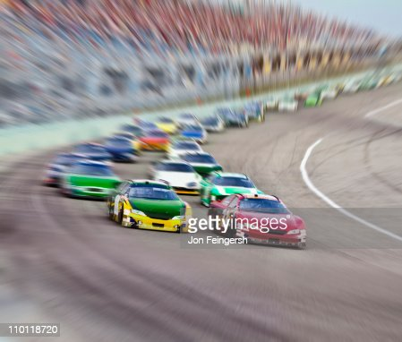 Race Cars Racing Around A Track Stock Photo Getty Images