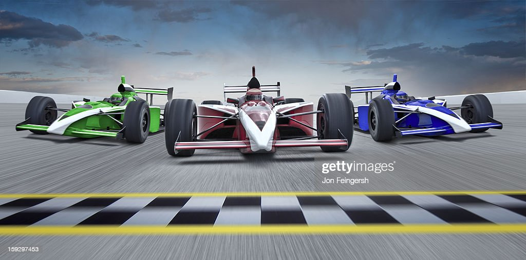 3 INDY race cars racing towards finish line. : Stock Photo
