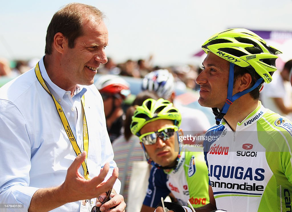 Race Director <a gi-track='captionPersonalityLinkClicked' href=/galleries/search?phrase=Christian+Prudhomme&family=editorial&specificpeople=546988 ng-click='$event.stopPropagation()'>Christian Prudhomme</a> chats to <a gi-track='captionPersonalityLinkClicked' href=/galleries/search?phrase=Ivan+Basso&family=editorial&specificpeople=228363 ng-click='$event.stopPropagation()'>Ivan Basso</a> of Italy and Liquigas-Cannondale at the start of stage five of the 2012 Tour de France from Rouen to Saint-Quentin on July 5, 2012 in Rouen, France.