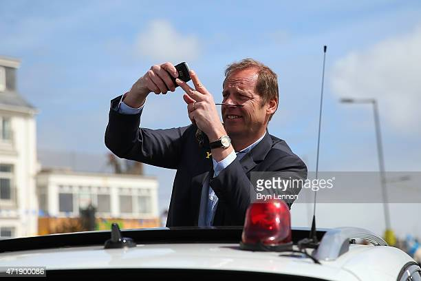Race Director Christian Prudhomme of ASO takes a photo at the start of stage one of the Tour de Yorkshire from Bridlington to Scarborough on May 1...