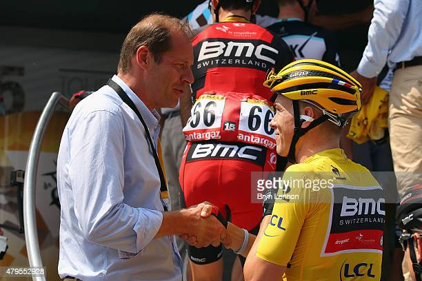 Race Director Christian Prudhomme shakes hands with race leader Rohan Dennis of Australia and the BMC Racing team at the start of stage two of the...
