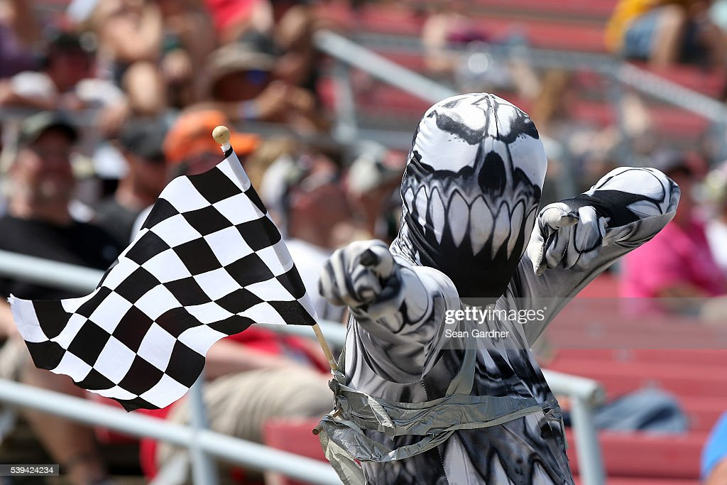 A race fan cheers on the action during the NASCAR XFINITY Series Menards 250 at Michigan International Speedway on June 11 2016 in Brooklyn Michigan