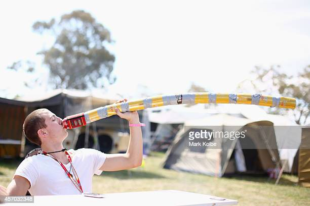 A race fan has a drink during the V8 Supercars Bathurst 1000 weekend at Mount Panorama on October 11 2014 in Bathurst Australia