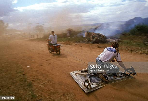 A race fan has a go at bonnet skiing at the donut pit during the 1999 FAI Bathurst 1000 at Mount Panorama November 14 1999 in Bathurst Australia
