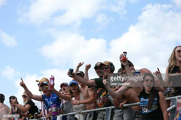 Race fans cheer during the NASCAR Nationwide Series Buckle Up 200 Presented By Click It Or Ticket at Dover International Speedway on May 31 2014 in...