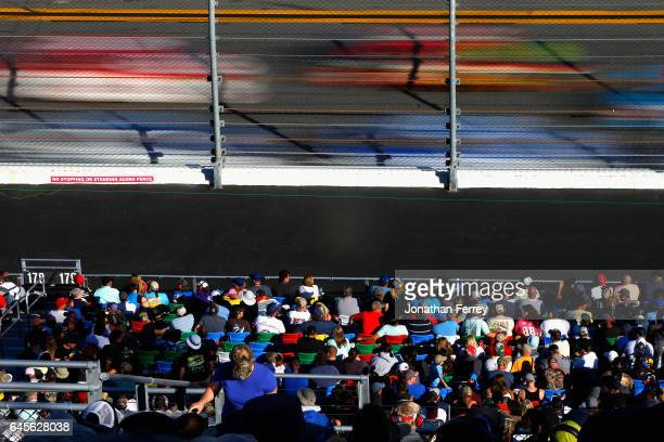 Race fans look on during the 59th Annual DAYTONA 500 at Daytona International Speedway on February 26 2017 in Daytona Beach Florida