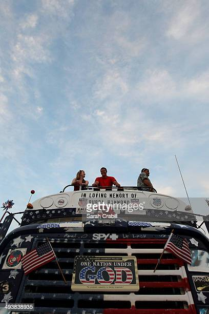 Race fans look on from the infield during the NASCAR Sprint Cup Series CocaCola 600 at Charlotte Motor Speedway on May 25 2014 in Charlotte North...